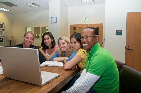 Group of Multicultural Students studying with laptop in student lounge Stock Photo
