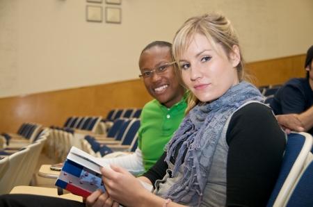講堂で多様な学生 写真素材