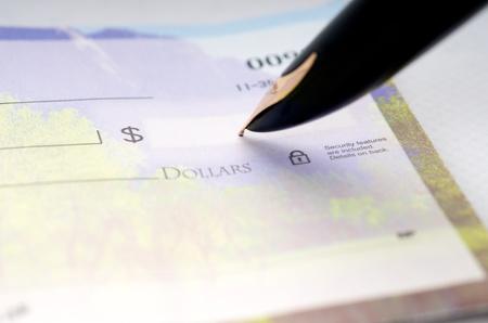 Writing a check Stock fotó
