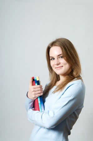 Beautiful girl with textbooks with white background Stock fotó