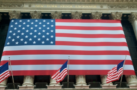 capitalism: USA Flags on Wall Street at the New York Stock Exchange NYSE, New York Editorial