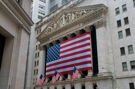 USA Flags on Wall Street at the New York Stock Exchange NYSE, New York Editorial