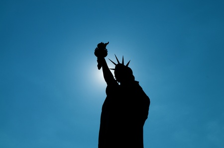 Silhouette of the Liberty Statue in New York City photo