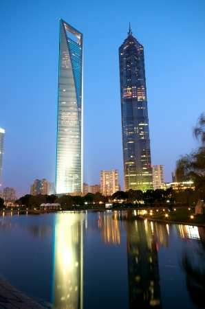 jin mao tower: Shanghai modern building at century avenue park at night
