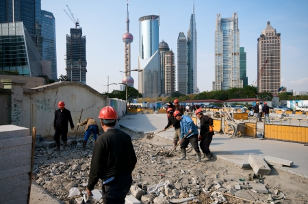 migrant: Shanghai in Construction workers prior Expo 2010 Shanghai in heavy construction prior to its Expo 2010, one of the most important event in the world  Construction workers from all over the country building Shanghai  Editorial
