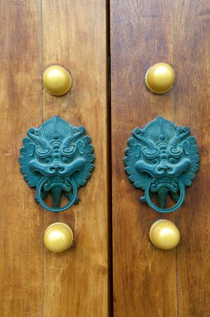 east gate: Dragon Door Handle at Jing An Temple Shanghai Stock Photo
