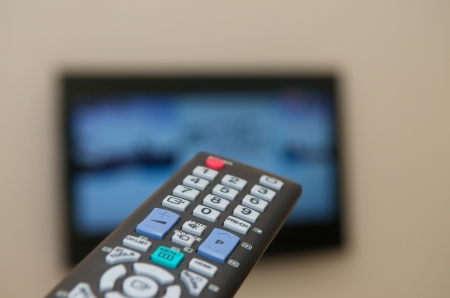 Watching TV with a remote
