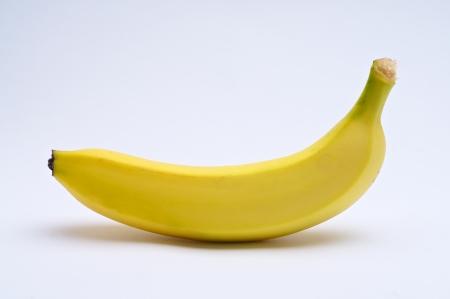 Yellow banana on white background Imagens