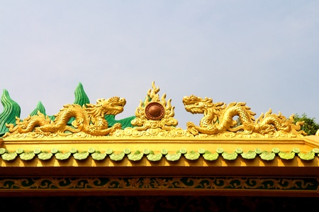 Dragon craft from a pagoda roof photo