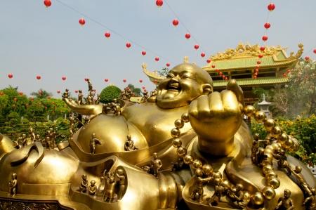 Golden Buddha in Da Nam Temple in Vietnam photo