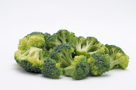 Chopped broccoli on white background. Imagens