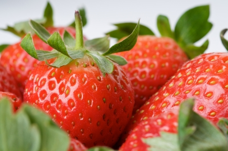 Strawberries close up in isolated white background