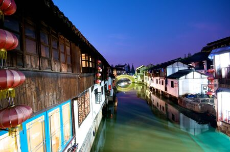 Chinese Water town on a river at night photo