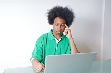 African American student in green Shirt with latop Stock Photo - 14990731