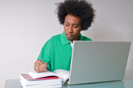 African American student studying with latop and textbooks Stock Photo - 14994417