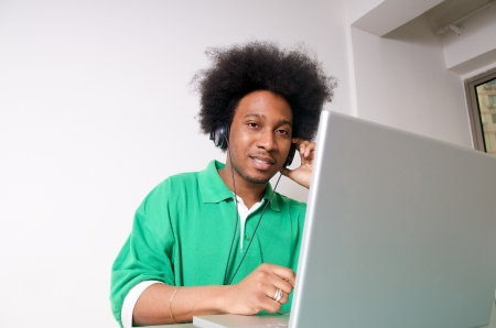 African American student listen to music with latop Stock Photo - 14994439