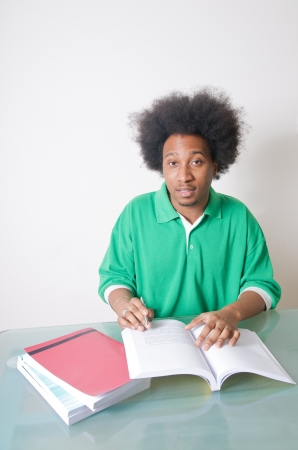 African American student studying with textbooks Stock Photo - 14994426