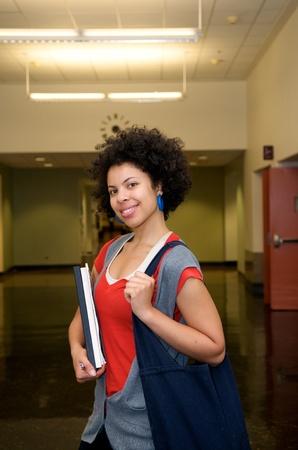 African American Student girl indoor in hallway photo