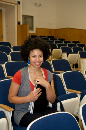 African American attending class in lecture hall photo