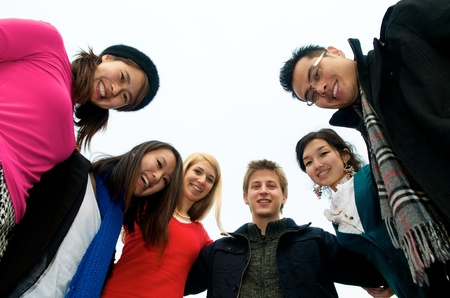 Group of 6 students outdoor in a circle photo
