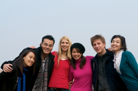 Group of multicultural students on campus photo