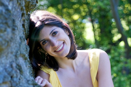 jewish ethnicity: Beautiful woman dreaming and leaning on a tree