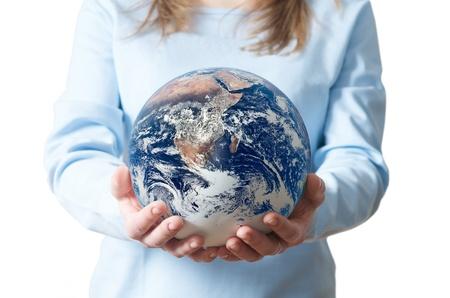 A young woman holding a globe, saving environment