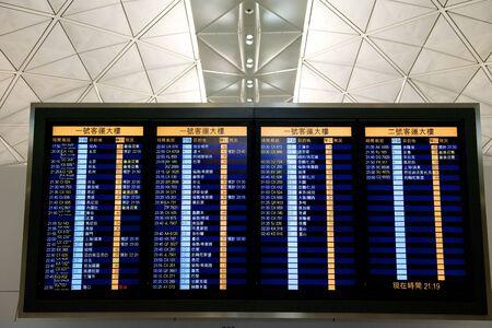 arrival departure board: Airport Departure display in Hong Kong China