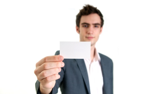 Professional young man holding business card