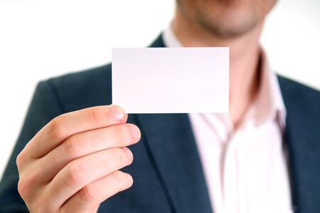 business cards: Professional young man holding business card