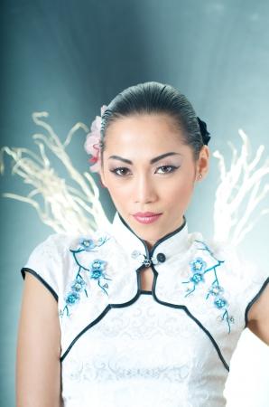 chinese dress: Beautiful Asian woman in Qipao dress