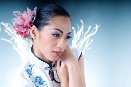 Beautiful Asian woman in Qipao dress