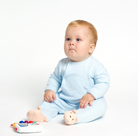 blond baby playing with toy