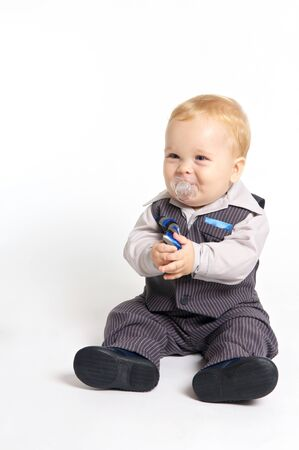 soother: blond baby with pacifier in formal suit Stock Photo