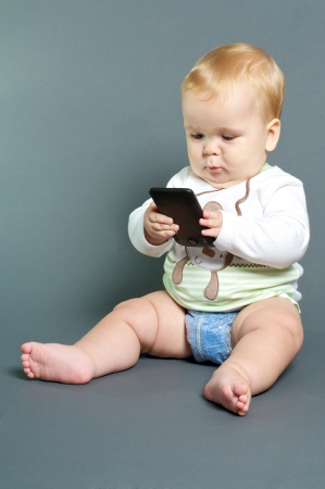 sms: blond baby texting with smart phone