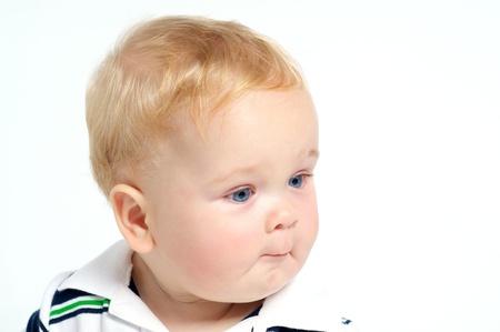 Funny blond baby with blue eyes portrait 版權商用圖片