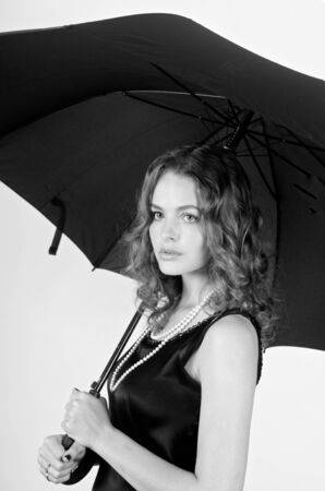 Beautiful brunette teenager woman holding umbrella photo