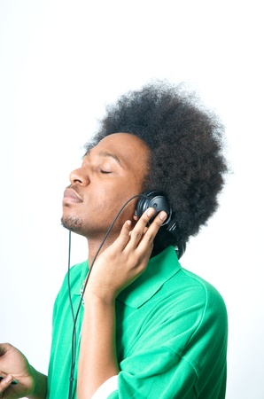 African American Teenager in green Shirt with listen to music Stock Photo