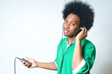 earphone: African American Teenager in green Shirt with listen to music Stock Photo