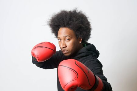 red gloves: Black Boxer with red boxing gloves in attack Stock Photo