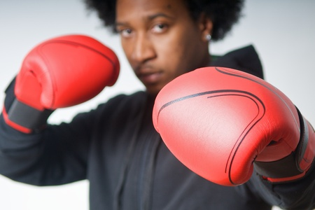 boy boxing: Black Boxer with red boxing gloves