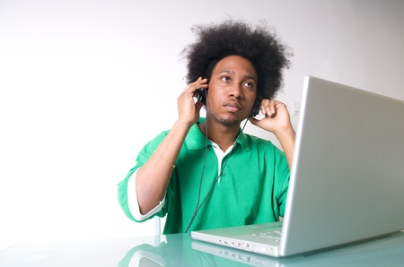 African American student listen to music with latop photo