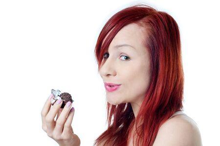 Beautiful girl is eating chocolate, temptation