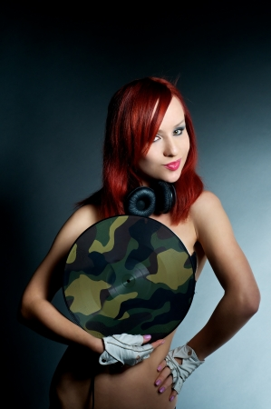 naked stylish female DJ covering with vinyl record photo
