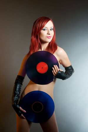 stylish naked DJ with record photo