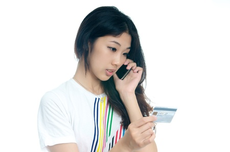 Chinese girl buying with Credit card photo