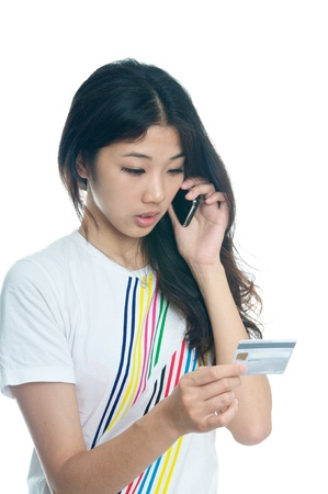 Chinese girl buying with Credit card Stock Photo - 15492615