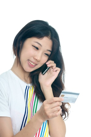 Chinese girl buying with Credit card Stock Photo - 15492614