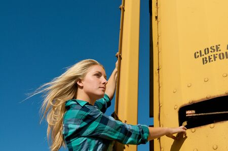 Blond girl hold on to a freight train