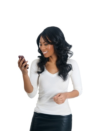 African American Woman reading message on the phone photo